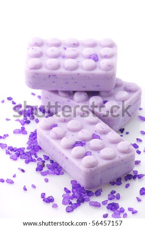 Three lilac soap and violet bath salt isolated on white background. - stock photo