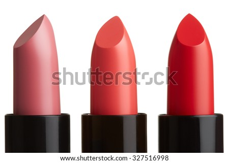 Three lipstick group in pink, red, coral color isolated on white, clipping path included - stock photo
