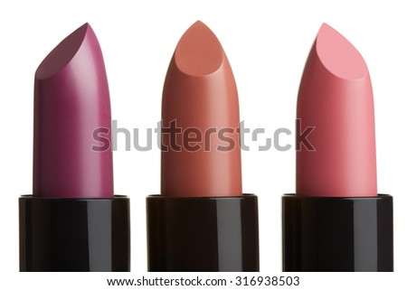 Three lipstick group in purple, brown, pink colors isolated on white, clipping path included
