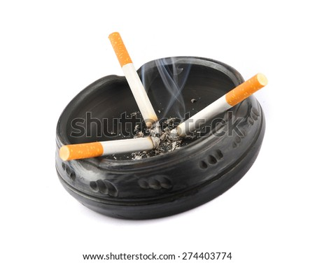 Three lit cigarettes in a black ashtray - stock photo