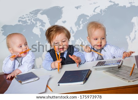 Three little businessman portrait in office - stock photo