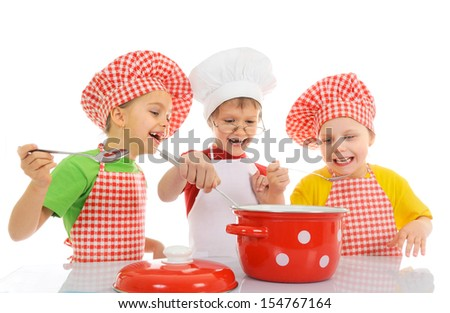 Three little chefs enjoying in the kitchen - stock photo