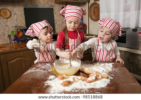 Three Little Chefs Enjoying In The Kitchen Making Big Mess