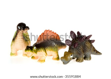 three little dinosaurs, isolated on a white background