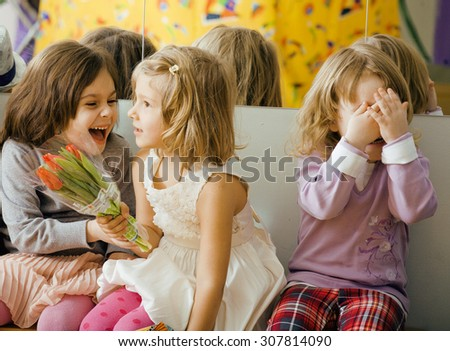 three little diverse girls at birthday party having fun
