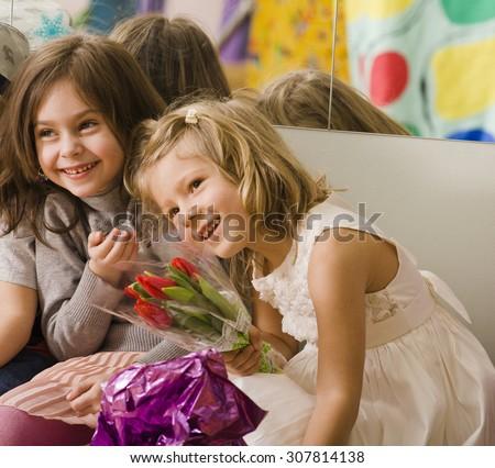three little diverse girls at birthday party having fun - stock photo