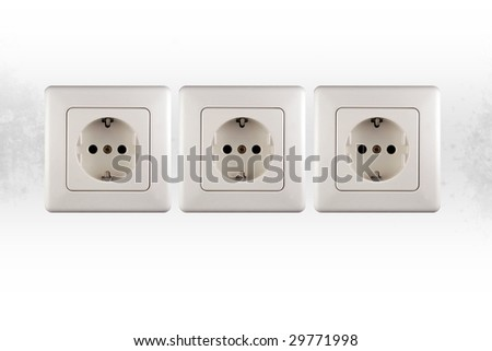 three little sockets of electricity in a wall