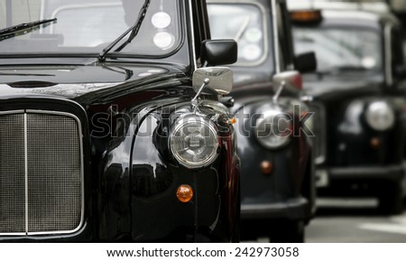 three London vintage cabs waiting in the street  - stock photo