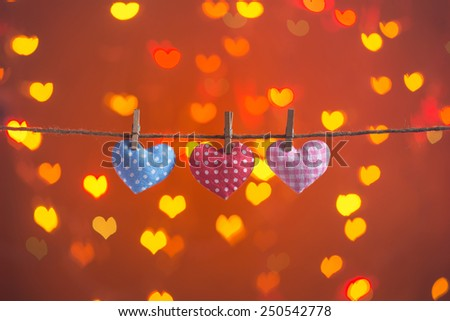 Three love hearts hanging on the clothesline. Copy space. Image of Valentines day. - stock photo