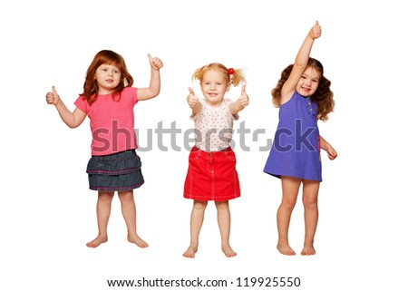 Three lovely smiling little girls, redhead, blonde and brunette, showing thumbs, OK sign or approval. Isolated on white background - stock photo