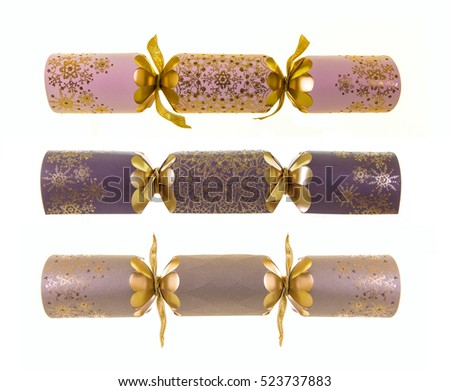 Three Luxury Christmas Crackers on a white background