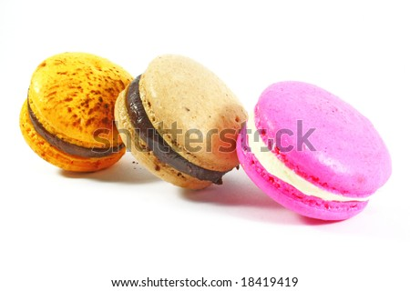 three macaroons in a displayed row - stock photo