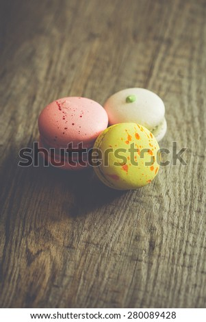 three macaroons on craft paper