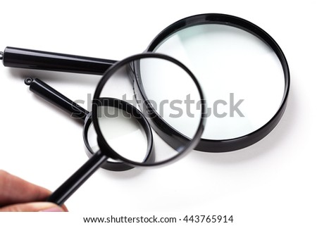 Three magnifiers over white
