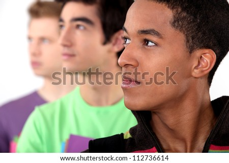 Three male college students - stock photo