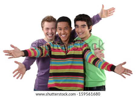 Three male friends making welcome gesture - stock photo