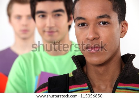 three male students posing in a line - stock photo