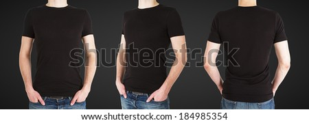 three man in black t-shirt on a black background - stock photo
