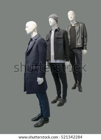 Three man mannequins dressed with fashionable autumn winter clothes, isolated. No brand names or copyright objects.