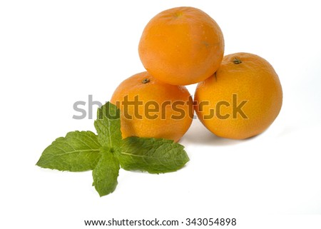 Three mandarins with a piece of mint isolated on white background