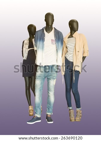Three mannequins dressed in casual clothes. Isolated on color background - stock photo