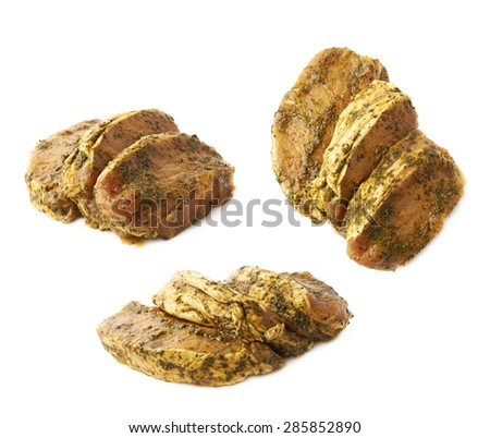 Three marinated with herbs beef slices isolated over the white background, set of three different foreshortenings - stock photo