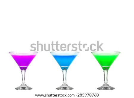 Three martini glasses with multicolor cocktails - cheers!! - stock photo