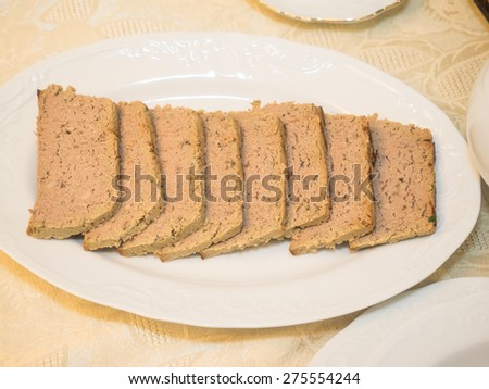 Three meat pate in a form ready for baking. - stock photo