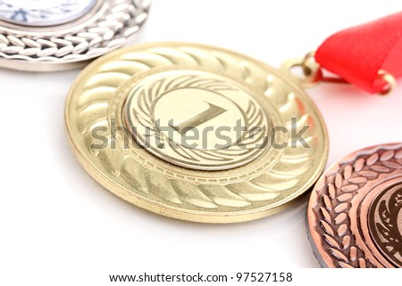 Three medals close-up isolated on white - stock photo