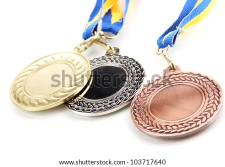 Three medals isolated on white - stock photo