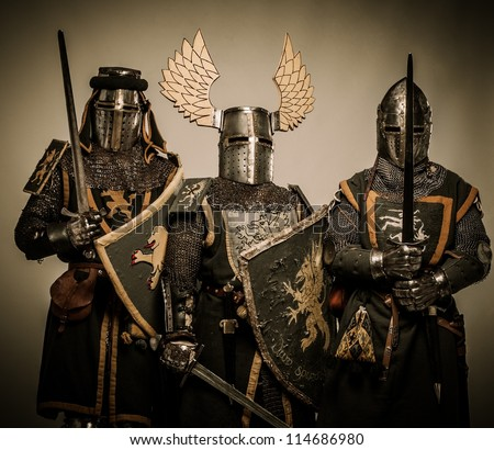 Three medieval knights - stock photo