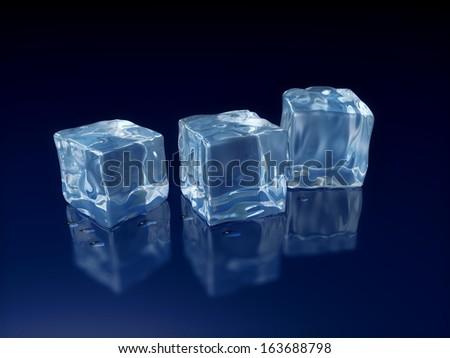 Three melting ice cubes on dark blue background - stock photo