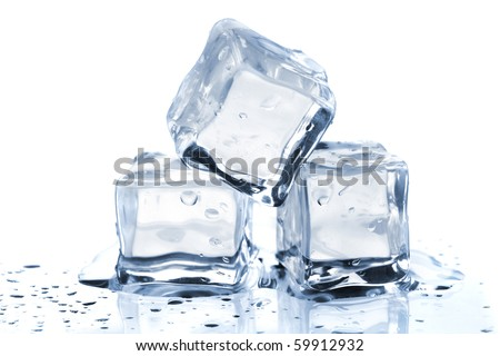 Three melting ice cubes on glass table. On white background - stock photo