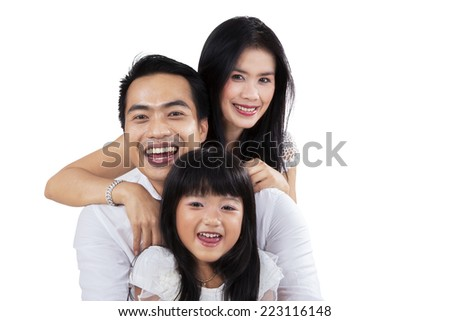 Three member of happy family laughing in studio while looking at camera - stock photo