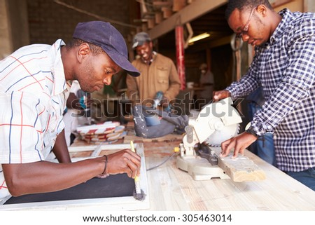 Three men at work in a carpentry workshop, South Africa - stock photo