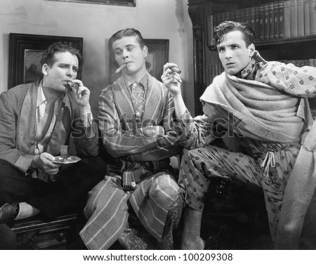 Three men smoking cigars - stock photo