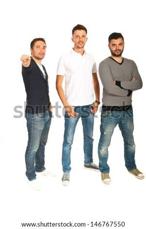 Three men standing in a row and one of them pointing to you isolated on white background - stock photo