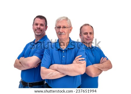 Three men with arms crossed.
