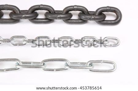 three metal chains of different size on white background - stock photo