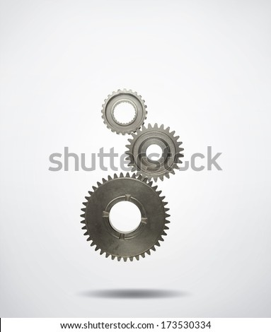 Three metal cog gears joining together  - stock photo