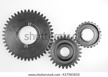 Three metal gears on plain background - stock photo