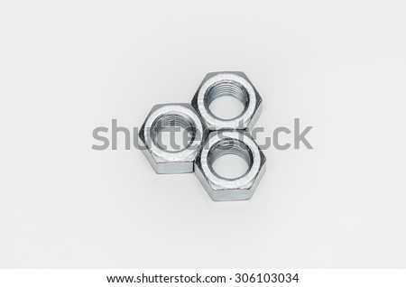 Three metal nuts isolated on white background