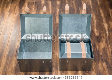 three metal tool box on wooden table, Studio Shot