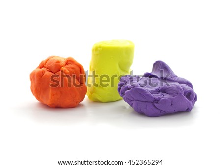 Three Modeling clay balls of different colors isolated on a white background - stock photo