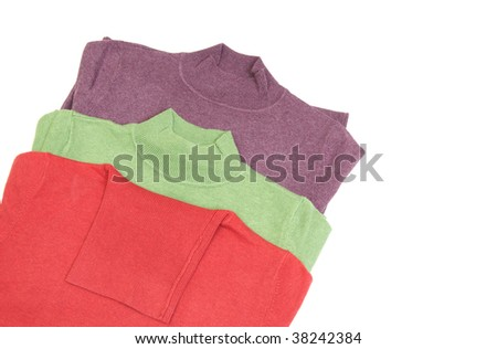 Three modern warm sweaters  isolated on a white background.
