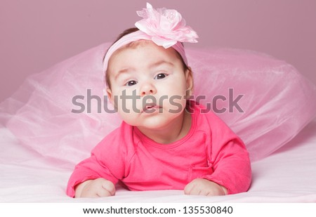 Three month old baby girl in pink tutu