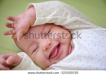 Three-month old smiling baby-girl puts the hands up. - stock photo