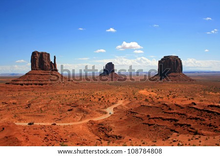 Three monuments in Monument Valley and the road