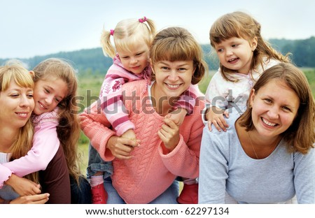 Three mothers have a good time with three daughters outdoors