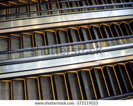 Three moving staircases without people